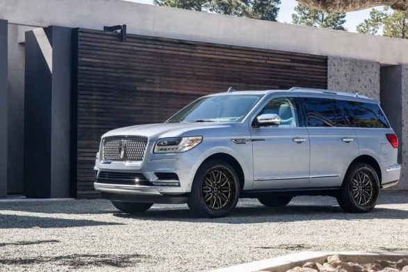 a 2019 lincoln navigator parked in a driveway