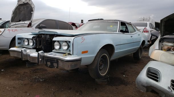 1974 Mercury Montego MX Brougham in Colorado junkyard, LH front view - ©2020 Murilee Martin - The Truth About Cars
