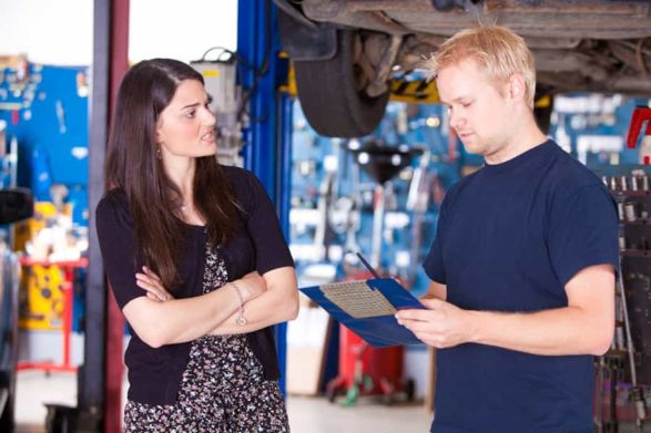 a mechanic gives a verbal estimate to a female customer