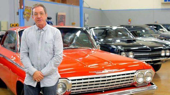 tim allen in front of his orange car