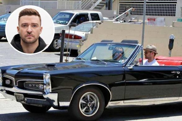 justin driving his vintage black convertible