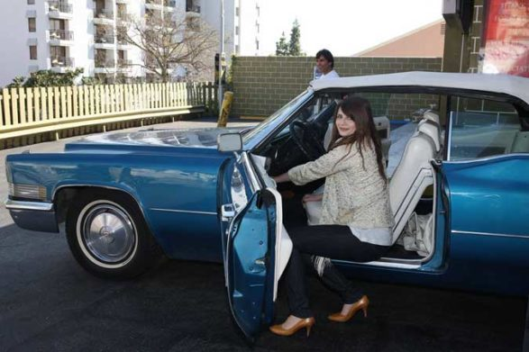 mischa barton getting out of her vintage car
