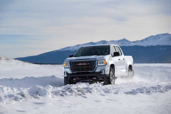 a white gmc canyon in the snow