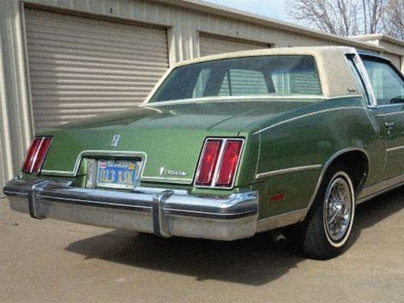 the tail end of a green oldsmobile cutlass supreme diesel