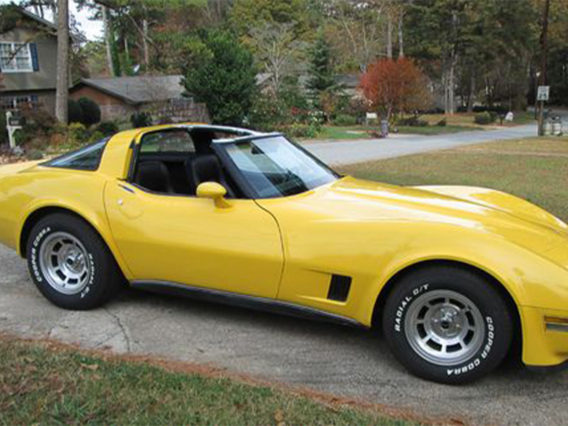 a yellow chevrolet corvette 305