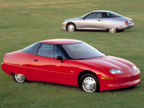 a red ev1 in the foreground and a silver ev1 in the background