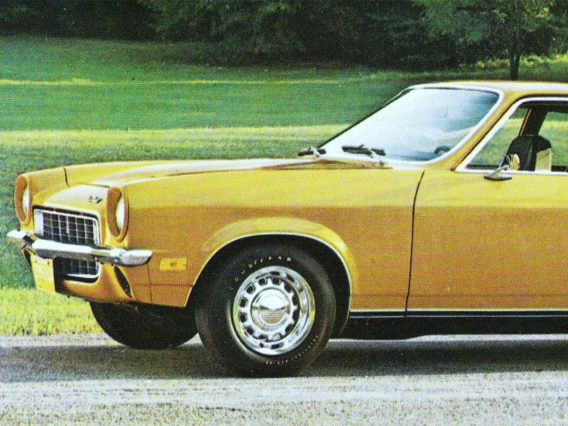only the front half of a yellow chevrolet vega is visible