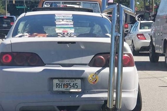 an economy car with exhaust pipes that direct upward as high as the car roof