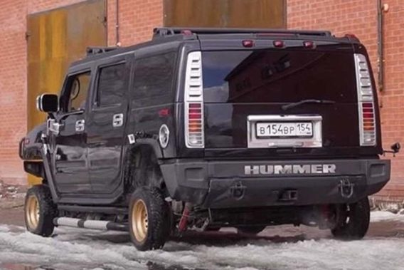 a large hummer with comically undersized small tires