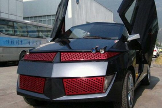 a completely custom Pontiac Aztek that is black and red resembling RoboCop or Transformers with scissor doors