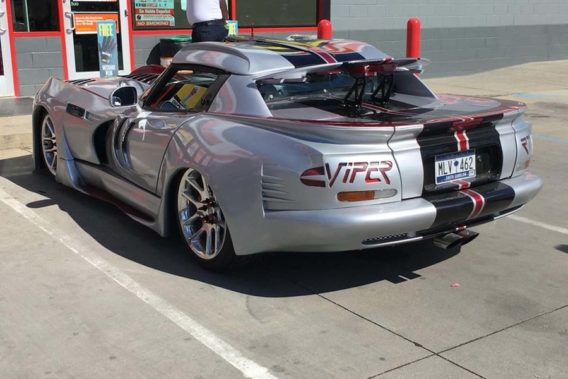 a heavily customized dodge viper with extra aerodynamic scoops along the sides, roof, and hood