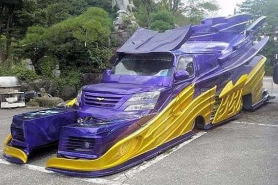 a purple and yellow van that looks almost like a dragon