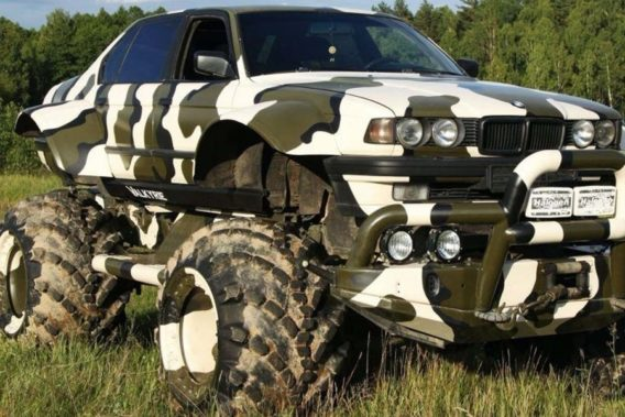 a lifted car with a black and white camo pattern