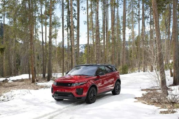 a red and black 2019 range rover evoque