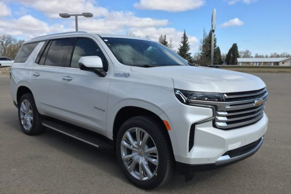 a 2021 white chevrolet tahoe on a dealership lot