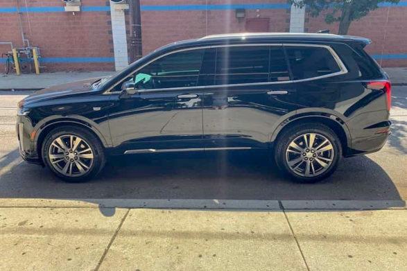 a black 2020 cadillac xt6 parked on a street